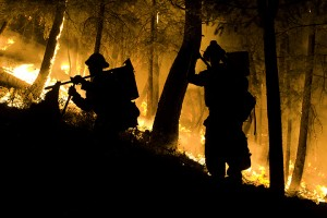 Firefighters in silhouette on the Castle Rock Fire, Idaho, 2007. Photo by Kari Greer.