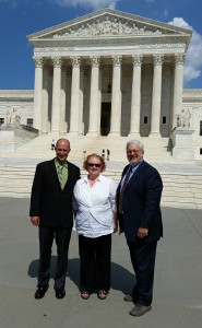 Brad Carlson, Kate McAllister and Phil Hough in front of the Supreme Court in Wash., D.C.