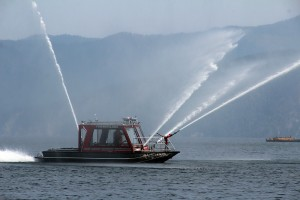 The Timberlake Fire Boat demonstrating the spraying capability off shore from Bayview. Photo by Ben Olson.