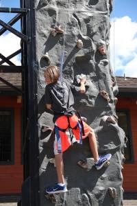 Anna Reinink climbs on the rock wall at Schweitzer Village. Photo by Ben Olson.