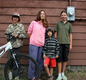 Krista Hess-Mills (center), stands with her family; Josiah (left), Arthur (middle) and Olive (right). Photo by Ben Olson.