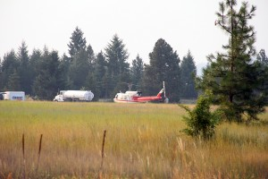 A helicopter and tanker are staged nearby at Farragut State Park for quick access. Photo by Ben Olson