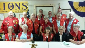 The Lions Club members. Back row (left to right): Sandpoint Chapter President Dave Bannister and Bill Lewis. Next row (left to right): George VanRossum, Wayne Henderson, Keith Leiber, and Tom Debrowski. Front standing row (left to right): Mike Reeb, Judy Debrowsky, Mary Leiber, and June Dull. Seated row (left to right): Claudia Bannister, Sandy VanRossum, Barbara Trudeau, Past Zone Chair Pat Nelson from Priest Lake, and Nancy  Lewis. Photo courtesy of the Sandpoint Lions Club.