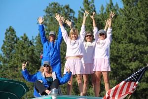 Five out of the six Mighty Mermaids celebrating on the support boat (Roni Hibben was swimming at the time of the photo). Photo by Ben Olson.