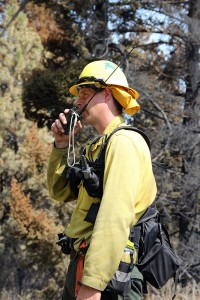 A member of the Missoula crew directs his firefighters up the hill at the Cape Horn fire. Photo by Ben Olson.
