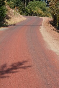 Cape Horn Road dyed red from fire retardant dropped during the outbreak last week. Photo by Ben Olson.