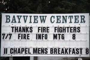 Signs like these greet firefighters and residents driving through Bayview. Photo by Ben Olson.