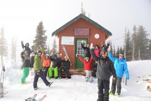 A crowd of locals hoists their beers outside the Wang Shack at the top of the Quad at Schweitzer. Photo by Ben Olson.