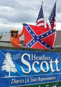 Rep. Heather Scott, R-Blanchard, poses with the Confederate flag at Timber Days in Priest River on July 25. Photo from her Facebook page.