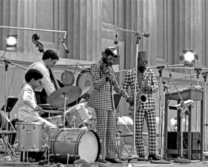 L to R: Denardo Coleman, Charlie Haden, Coleman and Dewey Redman, Hearst Greek Amphitheatre. Photo by Lee Santa.