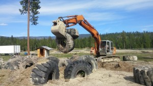 A dozer positions some of the repurposed tires. Photo courtesy Mountain Mafia Entertainment.