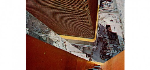 The World Trade Center towers under construction. Tim Henney had to sit on the photographer's feet while he hung out the window and snapped this shot. Photo by Bill Shropp.