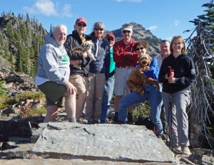 A group of supporters pose at the top of a group hike last Saturday. Photo by Phil Hough.