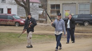 Kynan Dutton, Craig Cobb and Deb Henderson patrol their neighborhood in Leith, ND. Photo courtesy of Gregory Bruce.