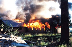A building at Richard Butler's Aryan Nations compound in Hayden Lake burns shortly after the group lost a $6.3 million lawsuit to the Southern Poverty Law Center, forcing the forfeiture of the property. Photo courtesy of SPLC.
