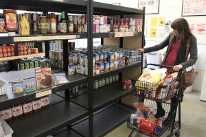 A local resident fills her cart at the Bonner County Food Bank. Photo by Ben Olson.