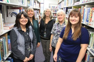 The lovely Library ladies, from left to right; Michelle Shorman, Teresa Sammartano, Library Director Ann Nichols, Susan Bates-Harbuck, and Amanda Ruff. Photo by Ben Olson.