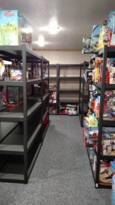 The shelves of toys at the Lions Den could use more toys!