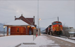 A trail pulling oil cars passes by Sandpoint's train depot. Photo by Marlin Thorman.