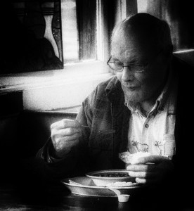 A man enjoys a meal at Monday's soup kitchen at the Hoot Owl Cafe. Photo by William G. Rosch.