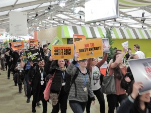 Young adults brought their passion and climate change demands throughout COP21. Photo by Gary Payton.