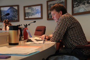 Councilman Bill Aitkin prepares before the council meeting. Photo by Ben Olson.