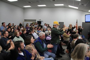 The audience cheers after Mayor Shelby Rognstad withdraws his tolerance resolution. Photo by Ben Olson.