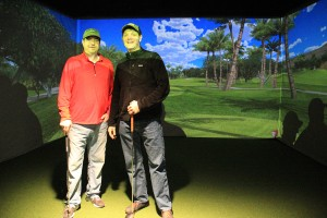John Bonar (left) and Jeff Boger (right) in front of the golf simulator screen. Photo by Ben Olson.