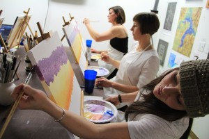 Kelsy, Courtney and Molly paint during Kris Dills' class at Infini Gallery. Photo by Ben Olson.