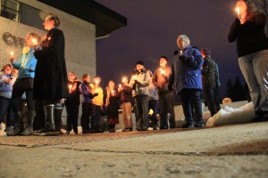 A candlelight vigil held by the Bonner County Human Rights Task Force greeted those coming and going from City Hall at Wednesday's council meeting. Photo by Ben Olson.