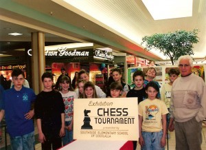 An exhibition chess tournament at the Silver Lake Mall, circa 1990. Lou Domanski is standing far right with his prodegies (the Reader publisher can also be found with a dumb smile on his face, two from the right in the back row. Photo courtesy of Cassadie Spinney.