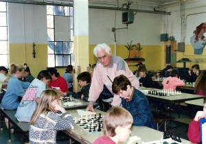 Lou Domanski looks over his budding chess prodigies at Southside Elementary School in 1990. Photo courtesy of Cassadie Spinney.