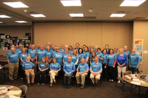 Members of the Wednesday Sandpoint Rotary Club meeting wear blue in support of World Autism Awareness Day, which falls on April 2. Photo by Ben Olson.