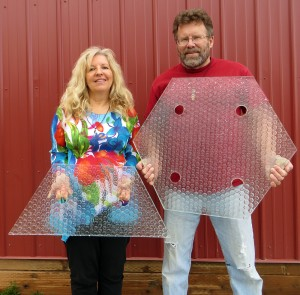 Scott and Julie Brusaw pose with a panel of glass. Courtesy of Solar Roadways.