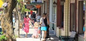 A family meanders down the First Avenue shopping district in Sandpoint. Photo by Ben Olson.