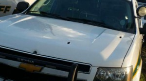 Bullet holes can be seen in the hood of the Sheriff's vehicle. Photo courtesy of Bonner County Sheriffs Office.