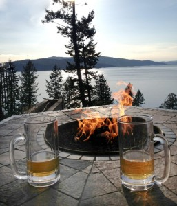 The outdoor fire feature that makes a great place to hang out and sip on a few cold ones in front of the lake.