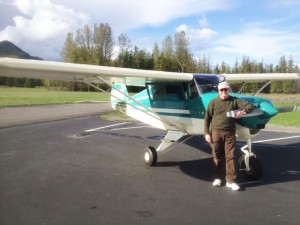 Jim Kaiser stands before his Piper Tripacer airplane. Photo by Jim Ramsey.