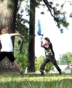 Luke Belden (in black) boffering at Lakeview Park. Belden makes, sells and studies swords. Photos by Jodi Rawson.