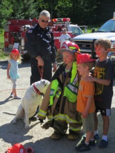 Area children get to try on the firefighting equipment and meet personnel. Photo courtesy of Sam Owen Fire District.