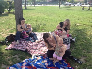 A trio of mothers breastfeeding at Travers Park in 2014. Photo by Angie Shadel.