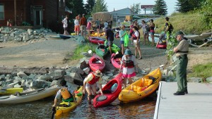 Kayak support vessels congregate at the south end of the Long Bridge at 2010's Long Bridge Swim. Photo by Sean Haynes.