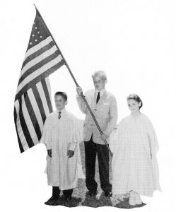 Donald Trump, center, holding the flag during a 1958 graduation at Kew-Forest School in Forest Lawn, NY.