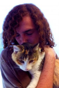 A recent photo of Adam Ferris with his special feline friend. Courtesy photo.