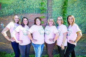 7B Women Committee members sport the new Boobs 'N Beer event shirts. From left to right:  Jesse Wurm, Alice Sloane, Sherri Lies, Gina Hall, Kim Diercks, and Jenn Markwardt. Photo by Cameron Barnes.