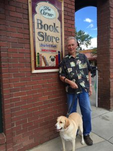 Owner Jim Orbaugh stands with Drake outside The Corner Bookstore.