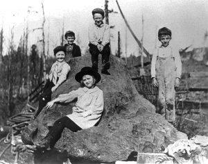 Five kids sit on the famed meteorite. Photo courtesy of Jack Nisbet.