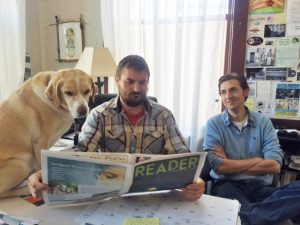 Drake, left, proofreads his latest column with publisher Ben Olson, center, and editor Cameron Rasmusson, right.