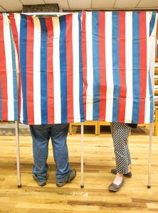 Voters cast their ballots at Sandpoint Community Hall on Tuesday. Photo by Cameron Barnes.