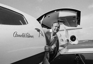 Arnold Palmer posing in his jet, circa 1960s. Photo courtesy of Creative Commons.